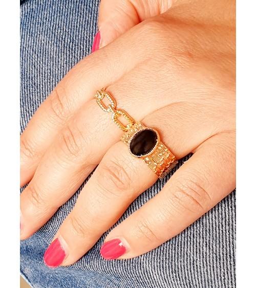 Bague en plaqué or avec une agate noire en son centre