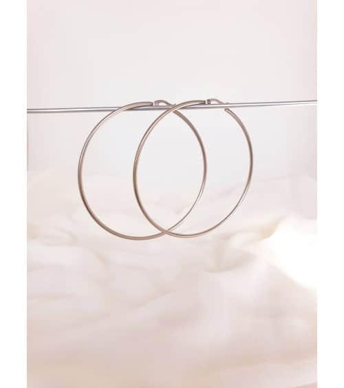 Boucles d'oreilles créoles en acier diamètre 70 mm