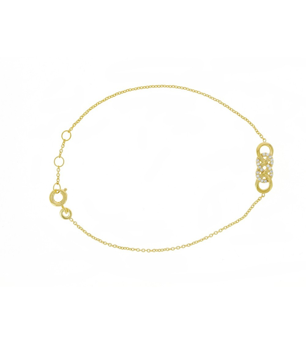Bracelet en plaqué or à 4 petits anneaux entrecroisés dont 2 sertis d'oxydes de zirconium