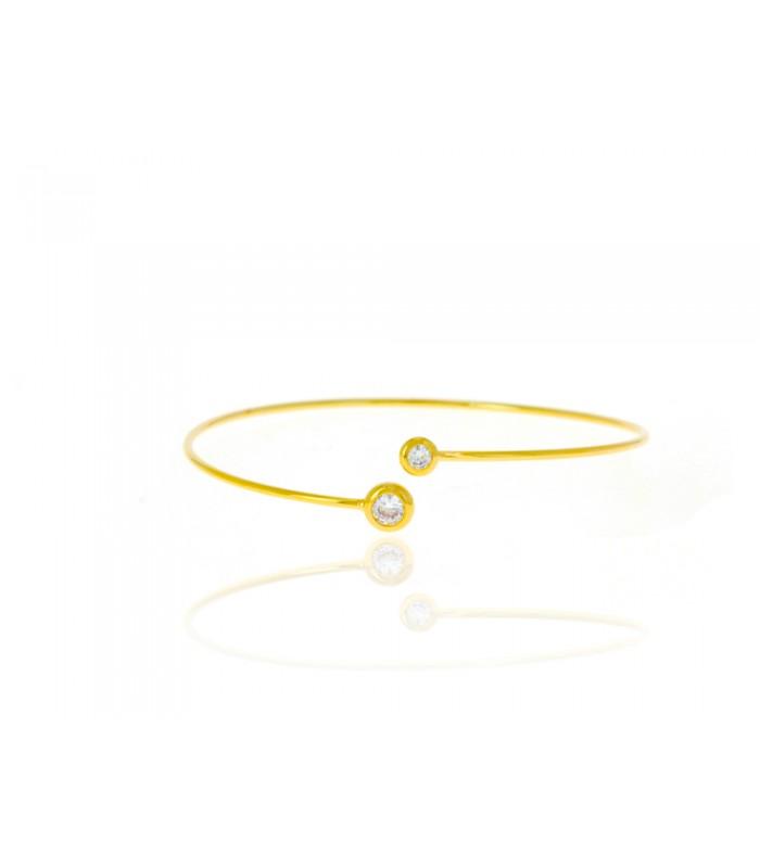 Bracelet ouvert en plaqué or, avec à chaque extrémité un oxyde de zirconium