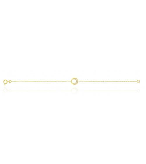 Bracelet en plaqué or avec un anneau serti de 5 oxydes de zirconium, en longueur 18 cm