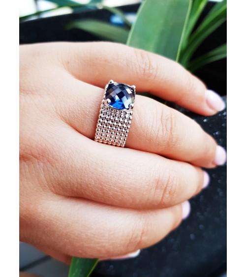 """Bague anneau à picots en argent 925/1000 rhodié,surmontée d'un oxyde de zirconium bleu """"saphir"""""""