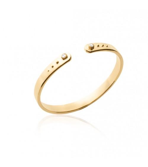 Bracelet ouvert en plaqué or avec à chaque extrémité un zirconium
