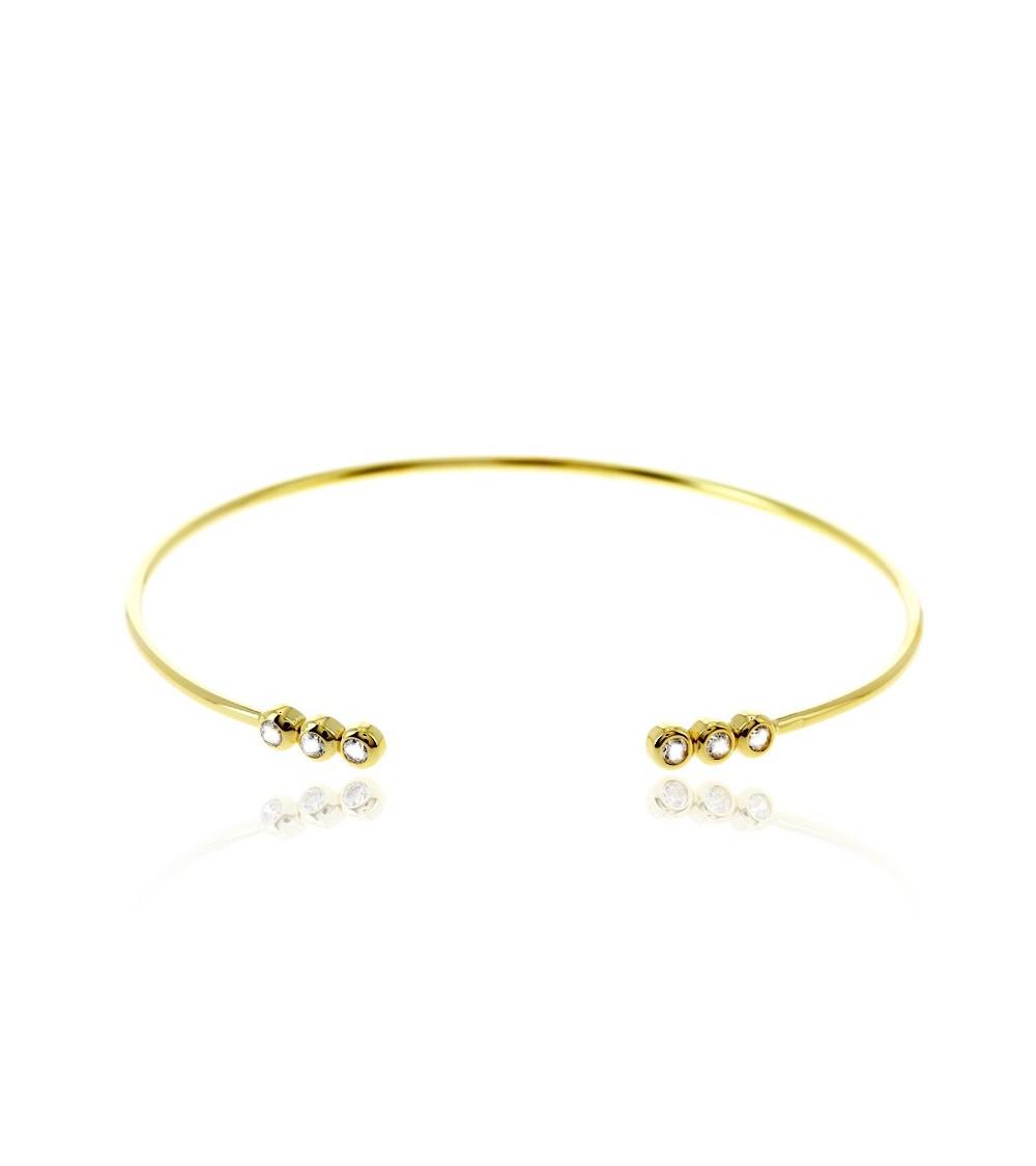 Bracelet rigide ouvert en plaqué or avec à chaque extrémité 3 oxydes de zirconium