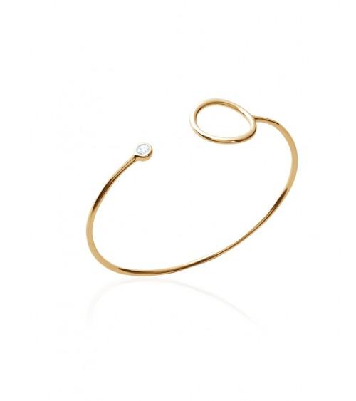 Bracelet ouvert en plaqué or avec à une extrémité un rond et à l'autre un oxyde de zirconium (diamètre 58 mm)