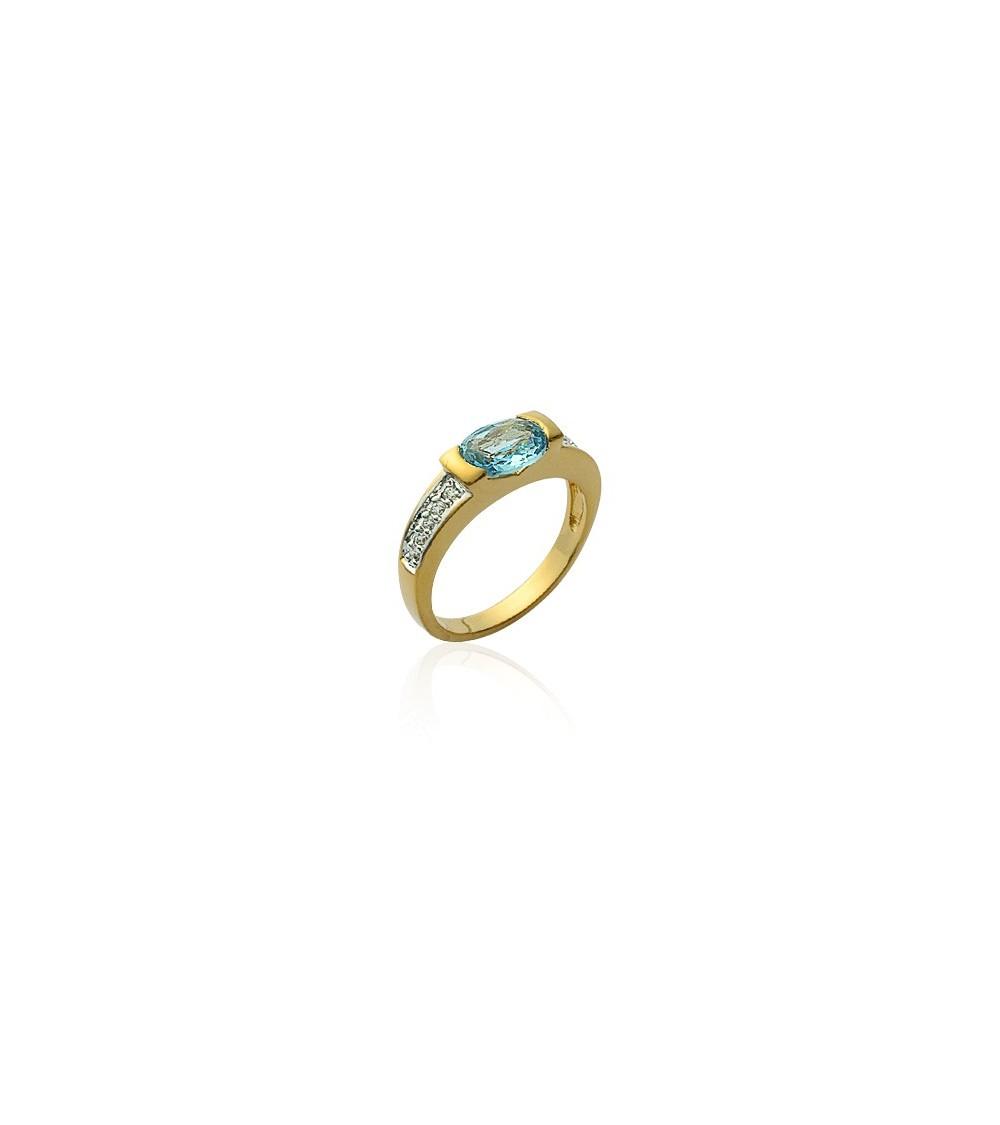 Bague en plaqué or et oxydes de zirconium blancs et ornée d'une pierre de synthèse bleu ciel