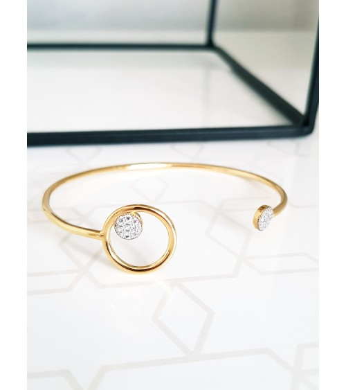 Bracelet ouvert en plaqué or avec un rond orné d'une pastille avec oxydes de zirconium et une autre pastille à l'autre extrémité