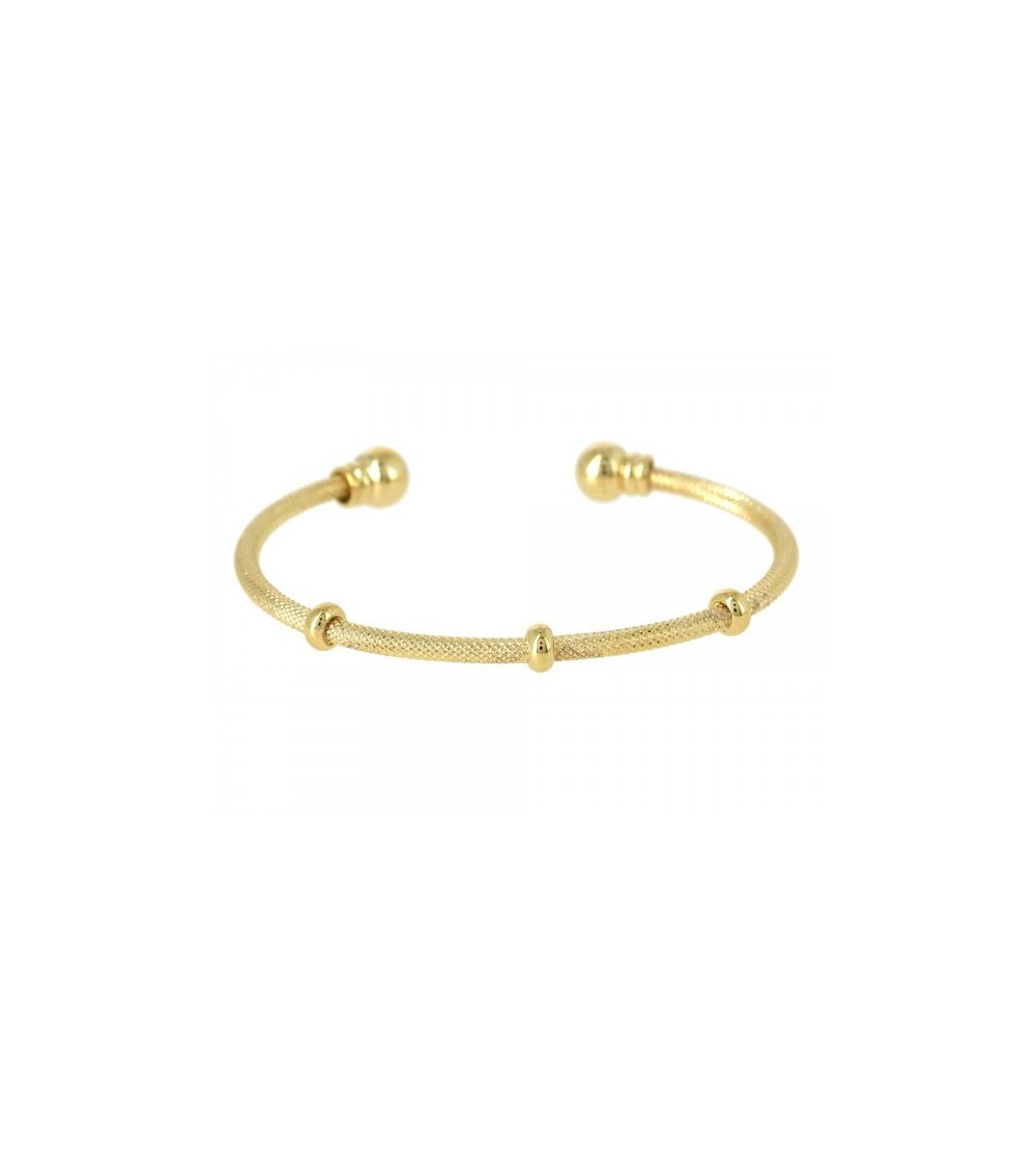 Bracelet rigide ouvert en plaqué or, comportant 3 intercalaires et 2 boules à chaque extrémité (diamètre 56 cm)