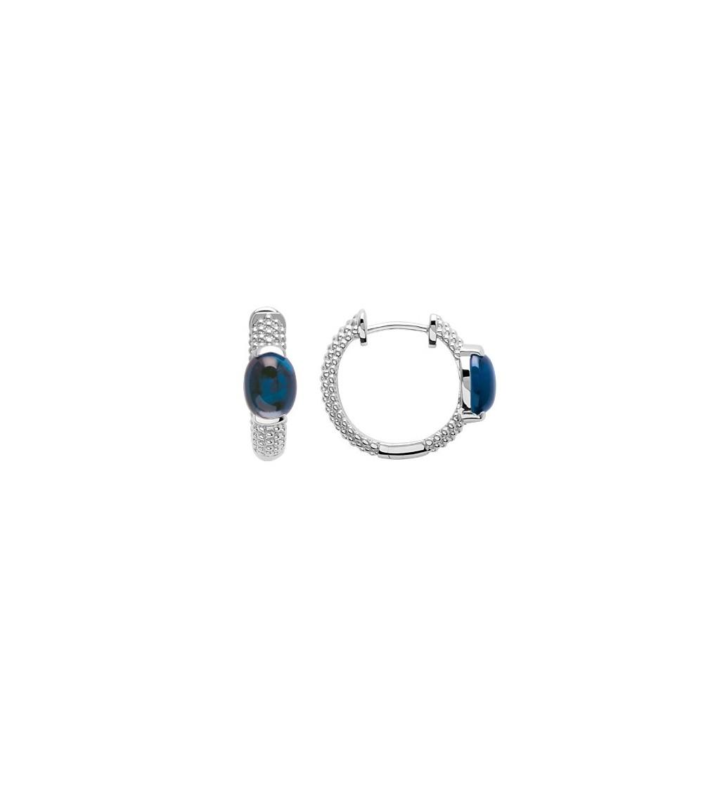 Boucles d'oreilles créoles en argent 925/1000 rhodié avec picots surmontées d'un oxyde de zirconium teinté bleu saphir