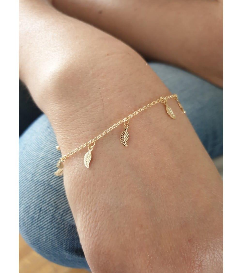 """Bracelet en plaqué or avec des pampilles """"feuilles"""", en longueur 20 cm réglable jusqu'à 17 cm"""