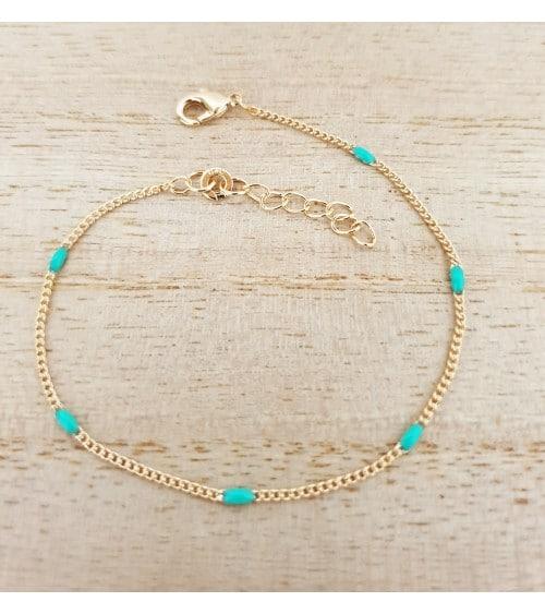 Bracelet en plaqué or avec des petites pierres ovales de couleur turquoise (longueur 19 cm réglable jusqu'à 16 cm)