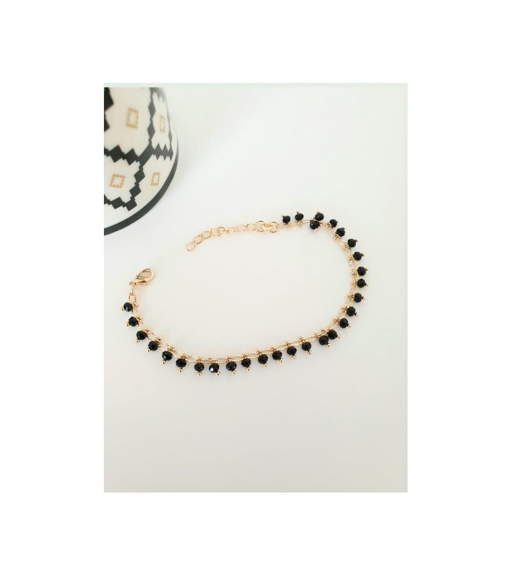Bracelet en plaqué or avec pampilles en pierres noires (longueur 17 cm + extension 3 cm)