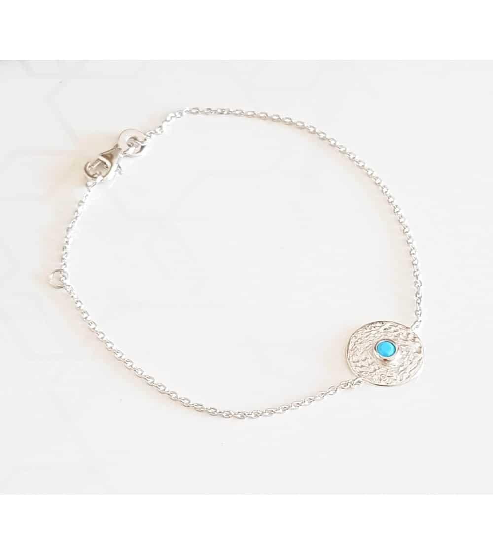 Bracelet en argent 925/1000 rhodié avec un rond surmonté d'une pierre de synthèse bleue turquoise
