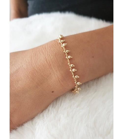 Bracelet en plaqué or avec pampilles en longueur 19 cm réglable à 17 cm